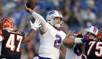 FILE - In this Aug. 26, 2018, file photo, Buffalo Bills quarterback Nathan Peterman (2) throws a pass during the second half of a preseason NFL football game against the Cincinnati Bengals, in Orchard Park, N.Y. The Buffalo Bills have named Nathan Peterman their starting quarterback in a job the second-year player is expected to hold until rookie first-round pick Josh Allen is deemed ready. The Bills made the announcement on their Twitter account before practice Monday morning, Sept. 3, 2018, as the team prepares for its season opener at Baltimore on Sunday. (AP Photo/Adrian Kraus, File)