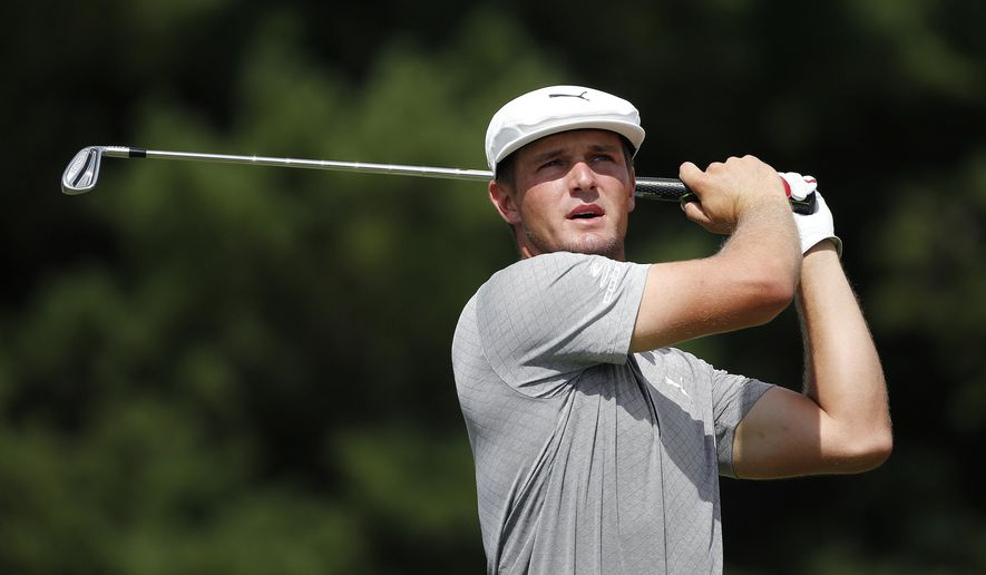 Bryson DeChambeau tees off on the third hole during the final round of the Dell Technologies Championship golf tournament at TPC Boston in Norton, Mass., Monday, Sept. 3, 2018. (AP Photo/Michael Dwyer)