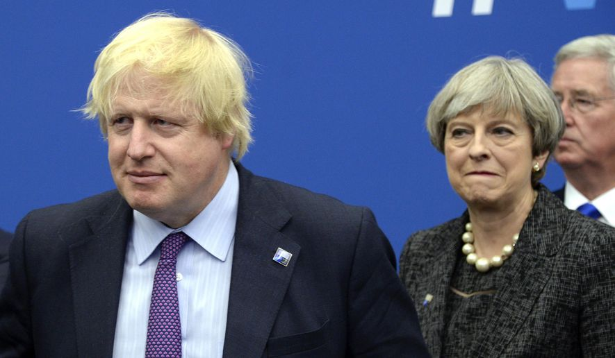 In this Thursday, May 25, 2017, file photo British Foreign Secretary Boris Johnson, left, and Britain's Prime Minister Theresa May arrive for a meeting during the NATO summit of heads of state and government, at the NATO headquarters, in Brussels. British ex-Foreign Secretary Boris Johnson has slammed Prime Minister Theresa May's Brexit policy, a move likely to fuel speculation that he is seeking to oust her. Johnson wrote in the Daily Telegraph on Monday Sept. 3, 2018, that May's so-called Chequers plan for continued ties with the European Union after Brexit will leave Britain in a weakened position. (Thierry Charlier/Pool Photo via AP, File)
