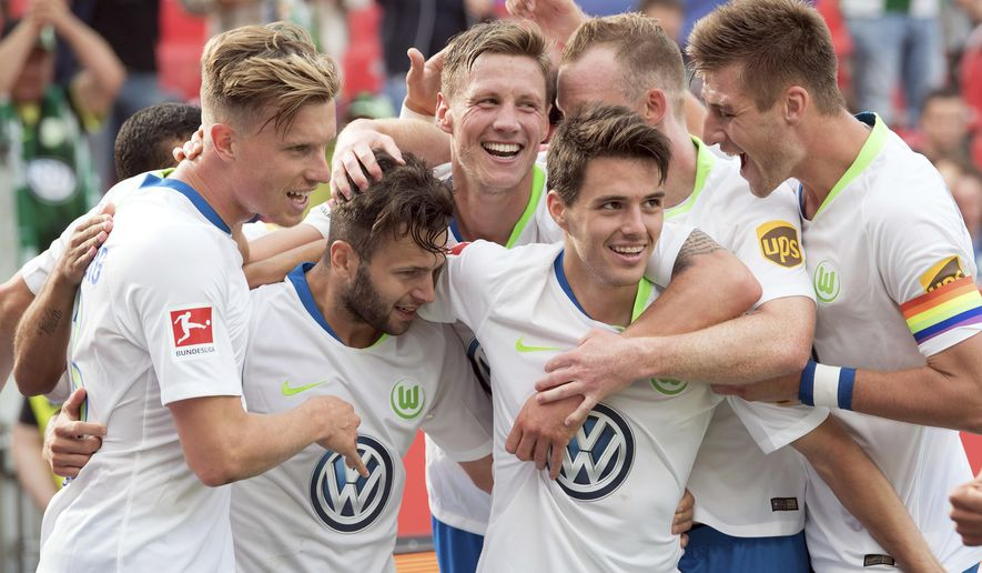 FILE -- In this Saturday, Sept. 1, 2018 photo Wolfsburg's players celebrate their side's 3rd goal during the German Bundesliga soccer match between Bayer 04 Leverkusen and VfL Wolfsburg in Leverkusen, Germany. Wolfsburg is bucking expectations after starting the Bundesliga with two wins over highly rated Schalke and Bayer Leverkusen. (Federico Gambarini/dpa via AP)