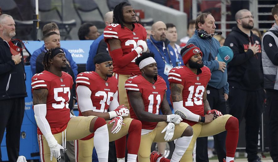 In this Dec. 24, 2017, file photo, San Francisco 49ers outside linebacker Eli Harold, from bottom left, kneels with safety Eric Reid, wide receiver Marquise Goodwin and wide receiver Louis Murphy during the national anthem before an NFL football game against the Jacksonville Jaguars in Santa Clara, Calif. (AP Photo/Marcio Jose Sanchez, File)