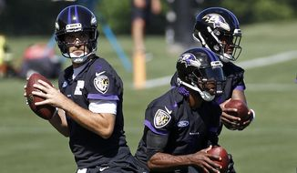 FILE - In this June 14, 2018, file photo, Baltimore Ravens quarterbacks Joe Flacco, from left, Robert Griffin III and Lamar Jackson run a drill during an NFL football practice at the team's headquarters in Owings Mills, Md. The Baltimore Ravens quarterback trio of Joe Flacco, Robert Griffin III and Lamar Jackson give coach John Harbaugh plenty of options. The starter is a former Super Bowl MVP, and the other two are Heisman Trophy winners. (AP Photo/Patrick Semansky, File)