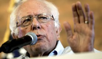 FILE - In this Aug. 17, 2018, file photo, U.S. Sen. Bernie Sanders, I-Vt, gestures as he speaks during a campaign stop for Democratic gubernatorial hopeful Andrew Gillum in Tampa, Fla. Sanders is scheduled to attend Labor Day events on Monday, Sept. 3, in New Hampshire and Vermont. (AP Photo/Chris O'Meara, File)