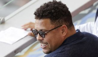 FILE - In this June 30, 2018 file photo, Brazil's former player Ronaldo watches a match between France and Argentina, at the 2018 soccer World Cup at the Kazan Arena in Kazan, Russia. Former Brazil striker Ronaldo is taking over recently promoted Spanish club Valladolid. Ronaldo announced Monday, Sept. 3 he has become the majority stakeholder in the small club from northern Spain. The former star says he hopes to bring his soccer expertise to help the club improve and be successful in the top tier of the Spanish league. (AP Photo/Sergei Grits, File)