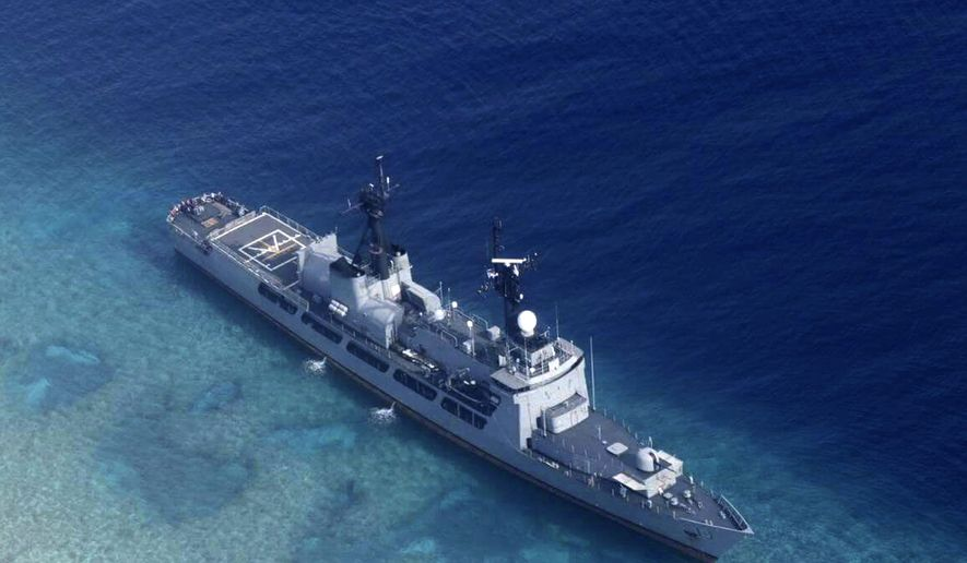 FILE - In this Aug. 29, 2018, file photo provided by the Armed Forces of the Philippines, the Philippine Navy ship BRP Gregorio del Pilar is seen after it ran aground during a routine patrol in the vicinity of Half Moon Shoal, which is called Hasa Hasa in the Philippines, off the disputed Spratlys Group of islands in the South China Sea. Two Philippine security officials told The Associated Press on Tuesday, Sept. 4, 2018, that tugboats were used to pull the BRP Gregorio del Pilar from the shallow fringes of Half Moon Shoal before midnight. The frigate ran aground during a routine patrol Wednesday night, damaging some of its propellers. It's more than 100 crewmen were unhurt. (Armed Forces of the Philippines via AP, File)