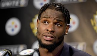 In this Oct. 22, 2017, file photo, Pittsburgh Steelers running back Le'Veon Bell (26) answers questions at a post-game meeting with reporters following a 29-14 win over the Cincinnati Bengals in an NFL football game in Pittsburgh. (AP Photo/Fred Vuich) ** FILE **