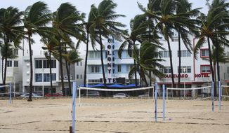 Volleyball courts on Lummus Park Beach, South Beach are empty as a tropical storm warning was issued for the Miami Beach, Fla., area on Monday, Sept. 3, 2018. Tropical Storm Gordon lashed South Florida with heavy rains and high winds on Monday, forcing holiday beachgoers to drier ground. (Carl Juste/Miami Herald via AP)