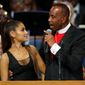 Bishop Charles H. Ellis III, right, speaks with Ariana Grande after she performed during the funeral service for Aretha Franklin at Greater Grace Temple, Friday, Aug. 31, 2018, in Detroit. Franklin died Aug. 16, 2018, of pancreatic cancer at the age of 76. (AP Photo/Paul Sancya)