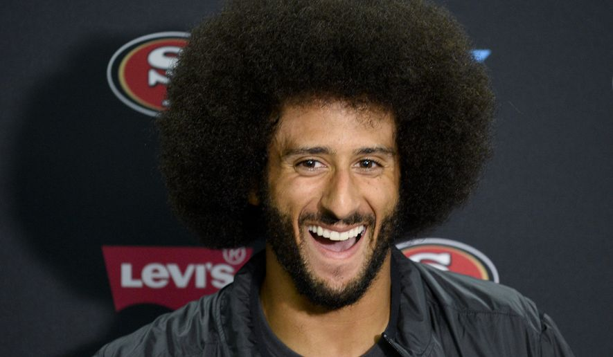 c086ab26 San Francisco 49ers quarterback Colin Kaepernick talks to the media at a  news conference an NFL