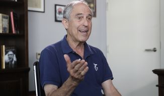 Attorney Lanny Davis speaks during an AP interview in his K Street office in Washington, Thursday, May 3, 2018. (AP Photo/J. Scott Applewhite) ** FILE **