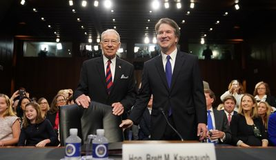 Supreme Court nominee Brett Kavanaugh, standing with Senate Judiciary Chairman Chuck Grassley, R-Iowa,  arrives at the Senate Judiciary Committee on Capitol Hill, Tuesday, Sept. 4, 2018, in Washington, to begin his confirmation hearing to replace retired Justice Anthony Kennedy. (AP Photo/Andrew Harnik)
