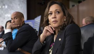 Sen. Kamala Harris, D-Calif., and Sen. Cory Booker, D-N.J., left, pause as protesters disrupt the confirmation hearing of President Donald Trump's Supreme Court nominee, Brett Kavanaugh, on Capitol Hill in Washington, Tuesday, Sept. 4, 2018. (AP Photo/J. Scott Applewhite) **FILE**