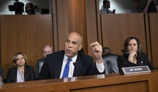 Sen. Cory Booker, D-N.J., and Sen. Kamala Harris, D-Calif., right, and other Democrats on the Senate Judiciary Committee appeal to Chairman Chuck Grassley, R-Iowa, to delay the confirmation hearing of President Donald Trump's Supreme Court nominee, Brett Kavanaugh, on Capitol Hill in Washington, Tuesday, Sept. 4, 2018. (AP Photo/J. Scott Applewhite)