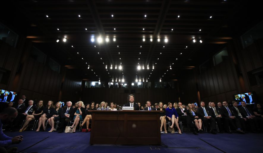 Supreme Court nominee Brett Kavanaugh, center, listens to lawmaker speak during a Senate Judiciary Committee nominations hearing on Capitol Hill in Washington, Tuesday, Sept. 4, 2018. (AP Photo/Manuel Balce Ceneta)