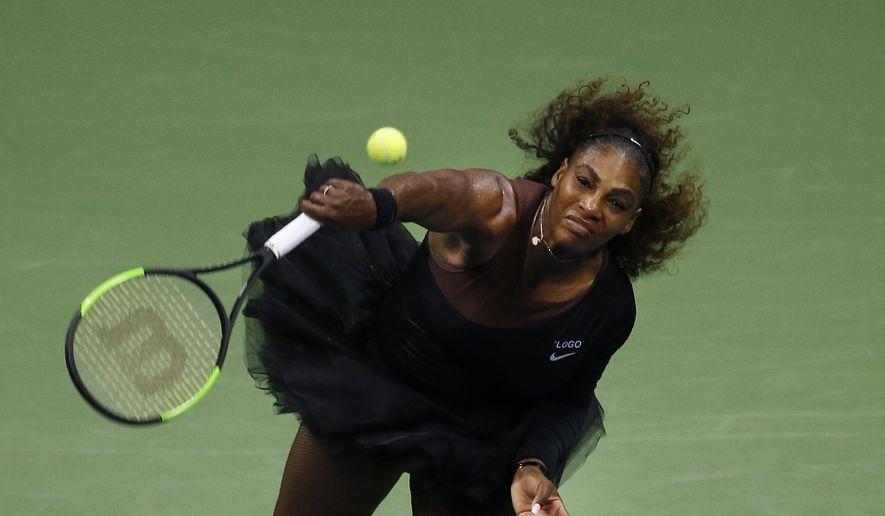 Serena Williams, of the United States, serves to Karolina Pliskova, of the Czech Republic, during the quarterfinals of the U.S. Open tennis tournament, Tuesday, Sept. 4, 2018, in New York. (AP Photo/Jason DeCrow)