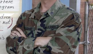 """In this photo provided by the Oklahoma National Guard, Sgt. Buddy James Hughie of Poteau, Okla., is pictured in a photo dated 2005 in New Orleans. A flight terminal in Kabul, Afghanistan, has been named in honor of Hughie, who was known as """"Doc"""". He was a medic and a member of Charlie Company, 1st Battalion, 180th Infantry Regiment when he was killed Feb. 19, 2007, in Afghanistan. (U.S. Army Oklahoma National Guard, Maj. Geoffrey Legle via AP)"""