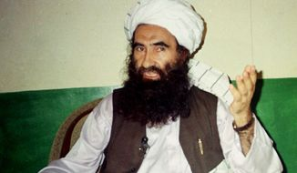 In this Aug. 22, 1998, file photo, Jalaluddin Haqqani, founder of the militant group the Haqqani network, speaks during an interview in Miram Shah, Pakistan. Taliban say the Afghan Haqqani network founder, Jalaluddin Haqqani, an ex- U.S. ally turned fierce enemy, has died. (AP Photo/Mohammed Riaz, File)