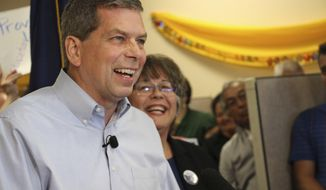 Democrat Mark Begich, left, shown here with his running mate Debra Call, right, refused calls to drop out of the Alaska governor's race during a press conference at his campaign office Tuesday, Sept. 4, 2018, in Anchorage, Alaska. Some Democrats and independents have worried that Begich and independent Gov. Bill Walker could split the vote, giving the race to Republican Mike Dunleavy. (AP Photo/Mark Thiessen)
