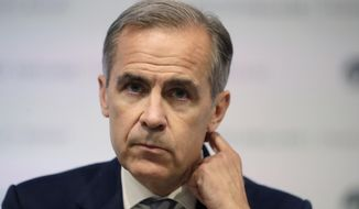 FILE - In this file photo dated Wednesday, June 27, 2018, Mark Carney the Governor of the Bank of England, during a press conference to deliver the Financial Stability Report at the Bank of England in the City of London.  Carney all but confirmed Tuesday Sept. 4, 2018, to a committee of lawmakers, that he is to stay at the helm of the central bank for longer than the planned June 2019 departure, to help ensure Britain leaves the European Union as smoothly as possible. (AP Photo/Matt Dunham, FILE)