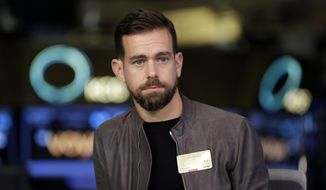 This Nov. 19, 2015, file photo shows Twitter CEO Jack Dorsey being interviewed on the floor of the New York Stock Exchange. Dorsey says the company isn't biased against Republicans or Democrats and is working on ways to ensure that debate is healthier on its platform. (AP Photo/Richard Drew, File)