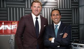 "In this Thursday, Aug. 16, 2018, file photo, former NFL player and now analyst Jason Witten, left, and play-by-play commentator Joe Tessitore pose for a photograph before their ESPN telecast of a preseason NFL football game between the Washington Redskins and the New York Jets in Landover, Md. Witten holds one of the most prominent television jobs in the sport as the lead analyst for Monday Night Football."" Witten is approaching his new role in similar fashion as he did his old one when his comprehensive film work made him the second most productive tight end in NFL history. (AP Photo/Alex Brandon) ** FILE **"
