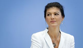 Sahra Wagenknecht arrives for the first press conference of the new political movement 'Stand Up' in Berlin, Germany, Tuesday, Sept. 4, 2018. Wagenknecht is co-faction leader of the German Left Party as well. (AP Photo/Michael Sohn)
