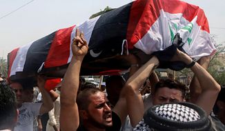 Mourners carry the Iraqi flag-draped coffin of Mekki Yasser, a protester whose family and activists said he was killed when he participated in a protest last night, during his funeral on Tuesday, Sept. 4, 2018, in Basra, about 340 miles (550 kilometers) southeast of Baghdad, Iraq. (AP Photo/Nabil al-Jurani)