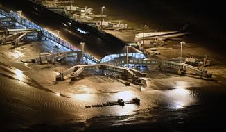 Kansai International Airport partially is flooded by typhoon Jebi in Osaka, western Japan, Tuesday, Sept. 4, 2018. A powerful typhoon blew through western Japan on Tuesday, causing heavy rain to flood the region's main offshore international airport and high winds to blow a tanker into a connecting bridge, disrupting land and air travel. (Nobuki Ito/Kyodo News via AP)