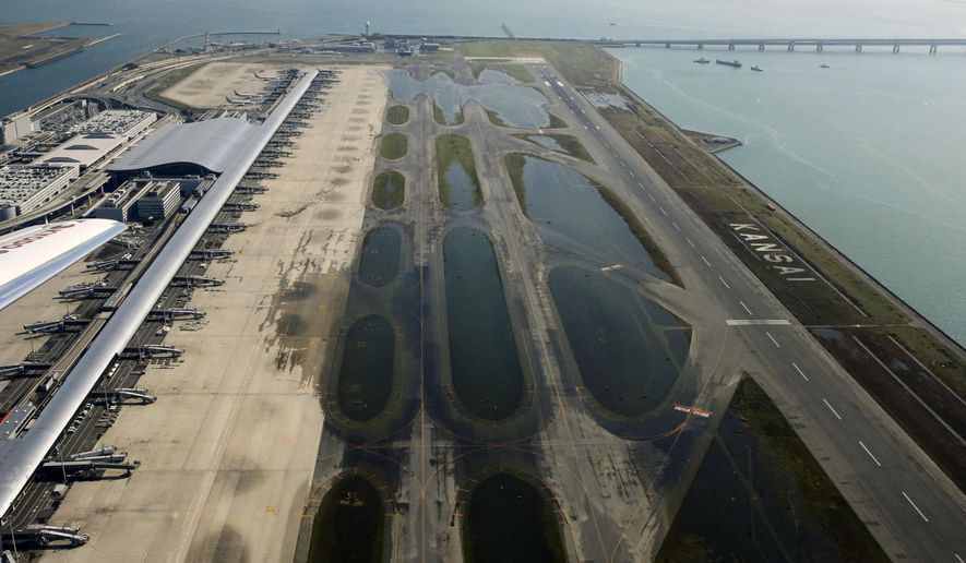 Kansai International Airport is partially flooded by Typhoon Jebi in Osaka, western Japan, Wednesday, Sept. 5, 2018. The powerful typhoon slammed into western Japan on Tuesday, inundating the region's main international airport and blowing a tanker into a bridge, disrupting land and air travel and leaving thousands stranded. (Hiroko Harima/Kyodo News via AP)