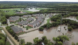 This Monday, Sept. 3, 2018, aerial photo taken with a drone and provided by the Riley County Department shows flooding near a residential area in Manhattan, Kan. Heavy rain caused a creek to burst its banks and flood the Kansas college town, forcing more than 300 people to evacuate their homes, including some who were ferried to dry land in boats. (Doug Wood/Riley County Police Department via AP)
