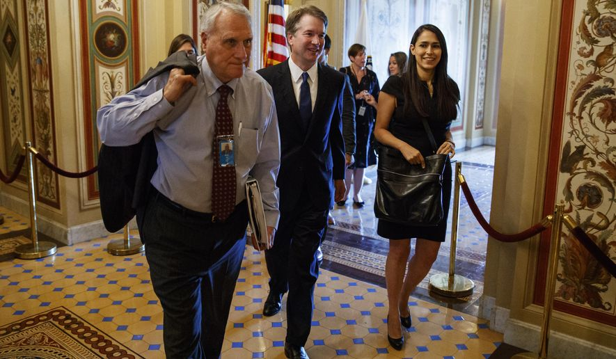 FILE - In this July 11, 2018, file photo, Supreme Court nominee Brett Kavanaugh is escorted by former Sen. Jon Kyl, R-Ariz., to a meeting on Capitol Hill in Washington. Sen. John McCain's widow on Tuesday, Sept. 4, 2018, said Kyl will fill her late husband's seat. (AP Photo/Evan Vucci, File)