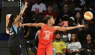 Washington Mystics forward LaToya Sanders (30) fends off Atlanta Dream forward Jessica Breland as she reaches for a rebound during the first half of Game 5 of a WNBA basketball playoffs semifinal Monday, Sept. 4, 2018, in Atlanta. (AP Photo/John Amis)