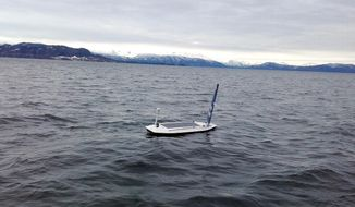 In this photo taken on March 14, 2018 and provided by Offshore Sensing, an autonomous Sailbuoy operated by Norwegian company Offshore Sensing performs a demonstration in the waters of Bjornafjorden, near Bergen, Norway. A Sailbuoy completed the Microtransat Challenge in late August, becoming the first to complete the trans-Atlantic challenge for autonomous vessels since the contest began in 2010. (Anders Barholm Larsen/Offshore Sensing via AP)