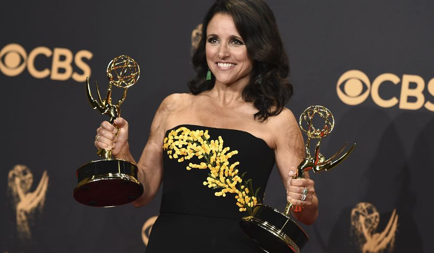 """Julia Louis-Dreyfus poses in the press room with her awards for outstanding lead actress in a comedy series and outstanding comedy series for """"Veep"""" at the 69th Primetime Emmy Awards at the Microsoft Theater in Los Angeles, Sept. 17, 2017. (Photo by Jordan Strauss/Invision/AP) ** FILE **"""