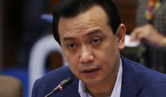 Philippine opposition Sen. Antonio Trillanes IV presides over a committee hearing on Civil Service Tuesday, Sept. 4, 2018 in suburban Pasay city, south of Manila, Philippines. President Rodrigo Duterte voided an amnesty given to the former rebel military officer, who has been elected senator and is now one of his fiercest critics, and ordered his arrest in a move opponents call illegal and a part of a political crackdown. (AP Photo/Bullit Marquez)