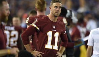 Washington Redskins quarterback Alex Smith stands on the sideline in the first half of a preseason NFL football game against the Baltimore Ravens, Thursday, Aug. 30, 2018, in Baltimore. (AP Photo/Gail Burton)