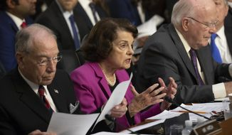 Sen. Dianne Feinstein, D-Calif., the ranking member on the Senate Judiciary Committee, flanked by Chairman Chuck Grassley, R-Iowa, left, and Sen. Patrick Leahy, D-Vt., right, makes an opening statement at the confirmation hearing of President Donald Trump's Supreme Court nominee, Brett Kavanaugh, on Capitol Hill in Washington, Tuesday, Sept. 4, 2018. (AP Photo/J. Scott Applewhite)