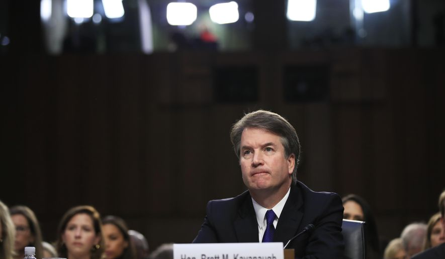 Supreme Court nominee Brett Kavanaugh, listens to lawmaker speak during a Senate Judiciary Committee nominations hearing on Capitol Hill in Washington, Tuesday, Sept. 4, 2018. (AP Photo/Manuel Balce Ceneta)