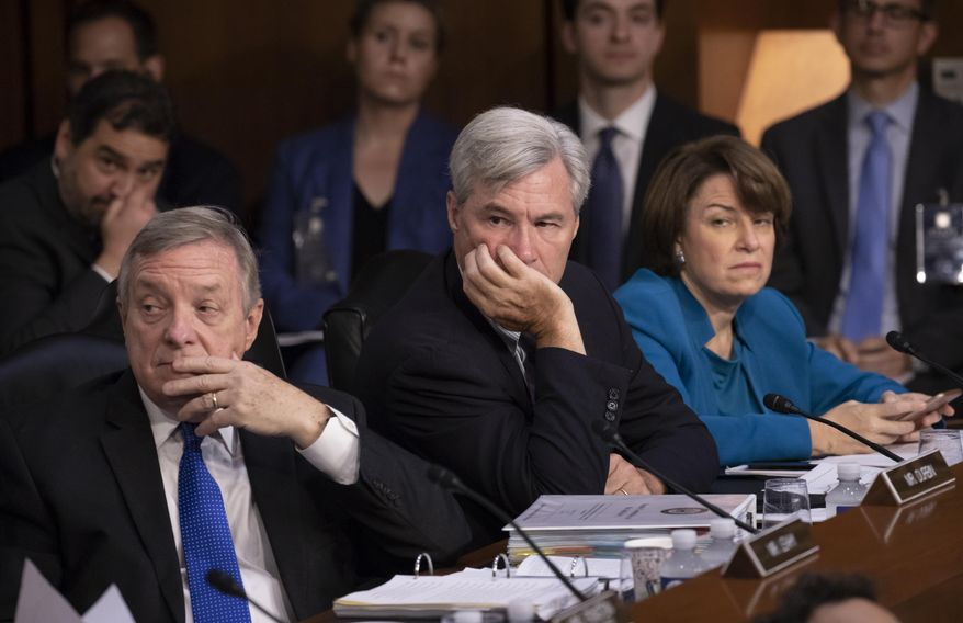 Democrats on the Senate Judiciary Committee, from left, Sen. Dick Durbin, D-Ill., Sen. Sheldon Whitehouse, D-R.I., and Sen. Amy Klobuchar, D-Minn., and other minority members, appeal to Chairman Chuck Grassley, R-Iowa, to delay the confirmation hearing of President Donald Trump's Supreme Court nominee, Brett Kavanaugh, on Capitol Hill in Washington, Tuesday, Sept. 4, 2018. (AP Photo/J. Scott Applewhite) ** FILE **