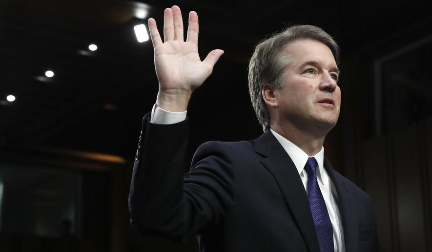 President Donald Trump's Supreme Court nominee Brett Kavanaugh is sworn in before the Senate Judiciary Committee on Capitol Hill in Washington, Tuesday, Sept. 4, 2018, to begin his testimony in his confirmation hearing to replace retired Justice Anthony Kennedy. (AP Photo/Jacquelyn Martin)