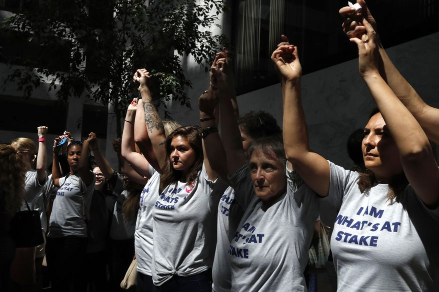 Women protest the nomination of Supreme Court nominee Brett Kavanaugh, Tuesday, Sept. 4, 2018, outside of a Senate Judiciary Committee confirmation hearing on Capitol Hill in Washington, at the start of his confirmation hearing to replace retired Justice Anthony Kennedy. (AP Photo/Jacquelyn Martin)