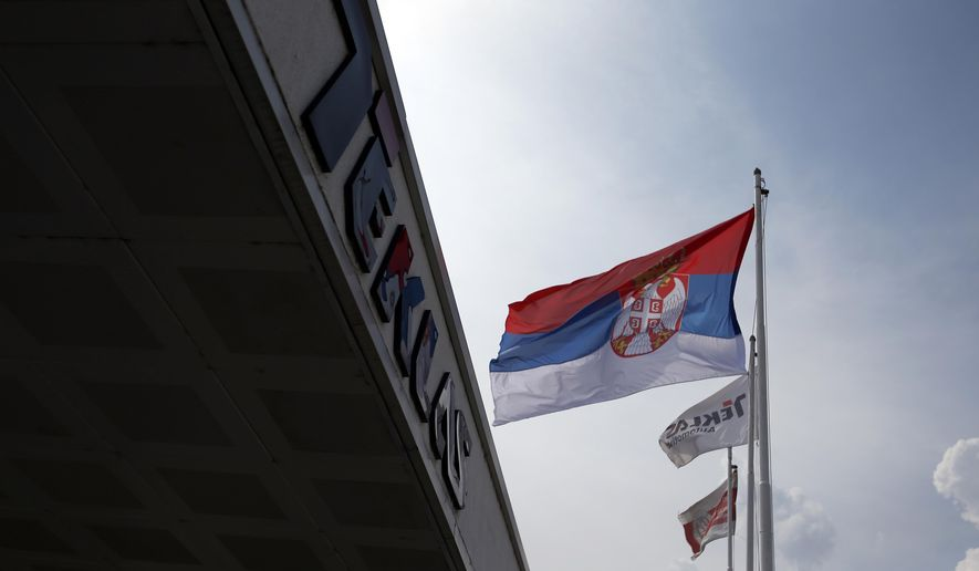 In this photo taken Friday, Aug. 31, 2018, a Serbian flag flutters at the Turkish Teklas Automotive plant in Vladicin Han, Serbia. The fall of the Turkish lira has raised concerns over the future of Turkish businesses in the investment-hungry Balkans. (AP Photo/Darko Vojinovic)