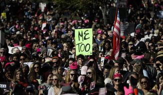 In this Jan. 20, 2018, file photo, protesters gather at the Grand Park for a Women's March against sexual violence in Los Angeles. A wave of sexual harassment complaints that accompanied the #MeToo movement is straining many of the state and local offices tasked with policing workplace discrimination of all kinds. (AP Photo/Jae C. Hong, File)