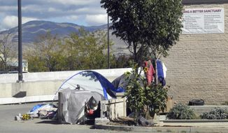 This undated file photo shows the entrance to an alley known as Cooper Court, a homeless camp in Boise, Idaho. A federal appellate court says cities can't prosecute people for sleeping on the streets if they have nowhere else to go. Boise is now challenging the ruling in a petition for the U.S. Supreme Court to hear the case. (Adam Cotterell/Boise State Public Radio via AP) **FILE**