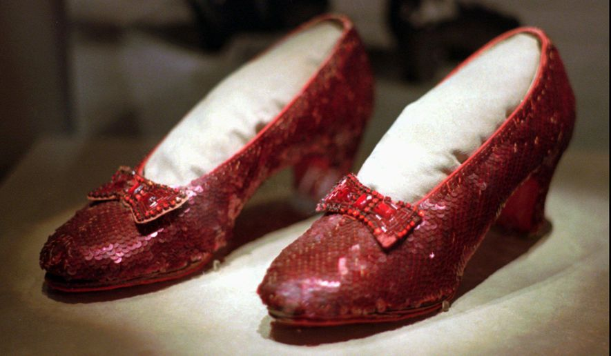 """This April 10, 1996, file photo shows one of the four pairs of ruby slippers worn by Judy Garland in the 1939 film """"The Wizard of Oz"""" on display during a media tour of the """"America's Smithsonian"""" traveling exhibition in Kansas City, Mo. Federal authorities say they have recovered a pair of ruby slippers worn by Garland that were stolen from the Judy Garland Museum in Grand Rapids, Minn., in August 2005 when someone went through a window and broke into the small display case. The shoes were insured for $1 million. (AP Photo/Ed Zurga, File)"""