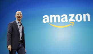 In this June 16, 2014, file photo, Amazon CEO Jeff Bezos walks onstage for the launch of the new Amazon Fire Phone, in Seattle. On Tuesday, Sept. 4, 2018, Amazon became the second publicly traded company to be worth $1 trillion, hot on the heels of Apple. The company's blowout success made its founder and CEO, Bezos, No. 1 on Forbes' billionaires list this year. (AP Photo/Ted S. Warren, File)