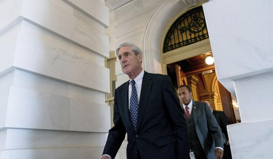 In this June 21, 2017, file photo, former FBI Director Robert Mueller, the special counsel probing Russian interference in the 2016 election, departs Capitol Hill following a closed door meeting in Washington. (AP Photo/Andrew Harnik)