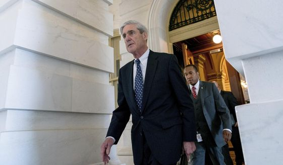 In this June 21, 2017, file photo, former FBI Director Robert Mueller, the special counsel probing Russian interference in the 2016 election, departs Capitol Hill following a closed-door meeting in Washington. (AP Photo/Andrew Harnik)