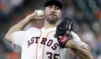 Houston Astros starting pitcher Justin Verlander throws against the Minnesota Twins during the first inning of a baseball game Tuesday, Sept. 4, 2018, in Houston. (AP Photo/Michael Wyke)