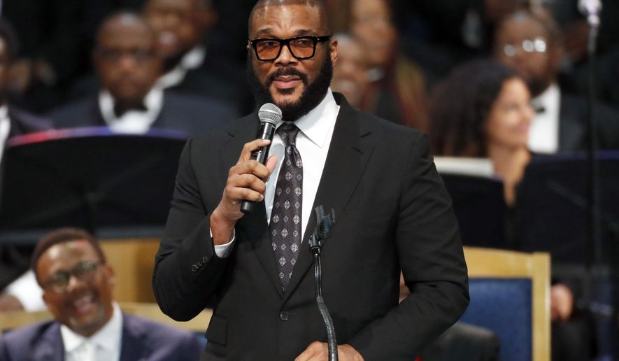 FILE - In this Friday, Aug. 31, 2018, file photo, filmmaker Tyler Perry speaks during the funeral service for Aretha Franklin at Greater Grace Temple in Detroit. Perry and attorney Benjamin Crump are scheduled Tuesday to make an announcement about Felipe Santos and Terrance Williams, who vanished after being detained separately by Collier County deputy Steven Calkins. He wasn't charged but was fired for not cooperating with investigators. Santos was Hispanic and Williams was black. Calkins is white. (AP Photo/Paul Sancya, File)